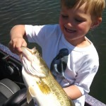 Mason Meseberg shows a 4lb largemouth bass he landed sight fishing with a Sniper Lure.