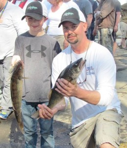 Nathan and Kyle Cox, Moses Lake residents, show some of their big walleye of the tournament.