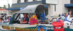 """Clark County (Wash.) Sheriff's Office boat in """"Wear-It"""" livery during the Hazel Dell Parade in Vancouver, Wash."""