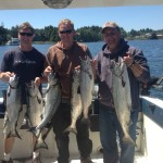 June 14: Friends Jim, Jeret and Dave with their limit of Chinook