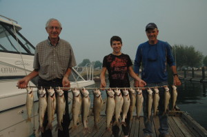 Neighbor Carl Davis with his grandson and Mr. Lesmeister with an epic morning catch of Mackinaw from Lake Chelan.