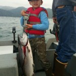 Floyd weighs the fish he caught…is it as big as dad's?