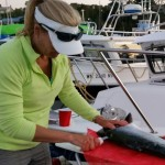 Vicki puts on a fillet show back at the docks. With a small folding table, it's easy to get your catch taken care of quickly.