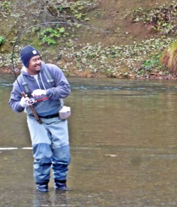 "A happy angler with ""Todd's loaner rod!"""