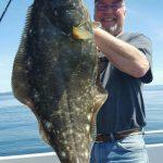 Scott Leeming's got a live one, headed for the fish box. Fresh Halibut tonight!