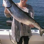 Karen Rhinehart with a fishy, headed for the BBQ.