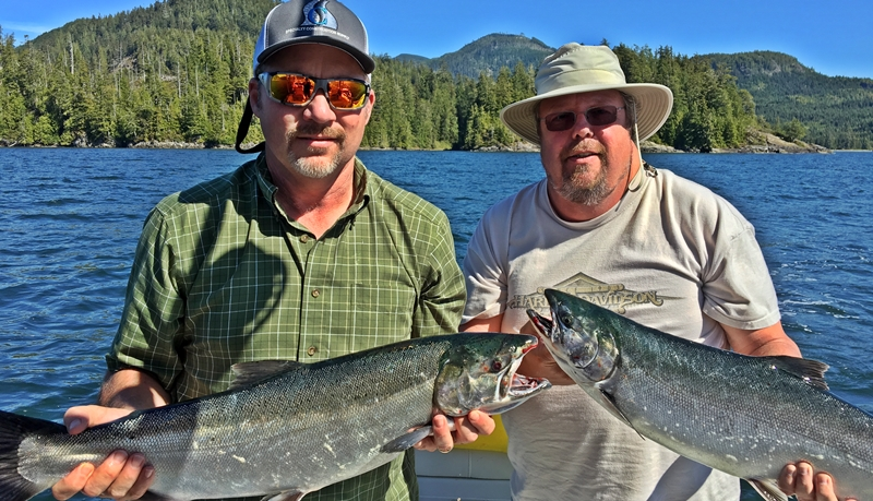 Tracy and Bryan fish with Doug of Slivers Charters and landed these two Coho as a double header at Assets Island