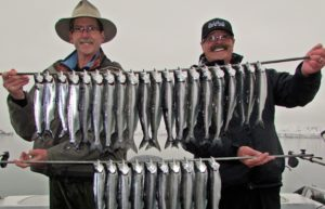 Dave (The Fishing Magician, AKA: The Commish) with brother Rick (the grand old guide of the lake ) Graybill's with their and Jeff's Kokanee.